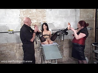 Feet tortures of slave Elise Graves in dungeon bondage and gruesome foot fetish