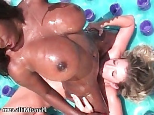 Interracial lesbian sex by the pool
