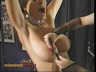 Beautiful brunette looker enjoys having some kinky bdsm fun with a redhead