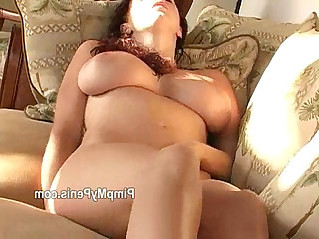 Gianna michaels plays with pussy on couch